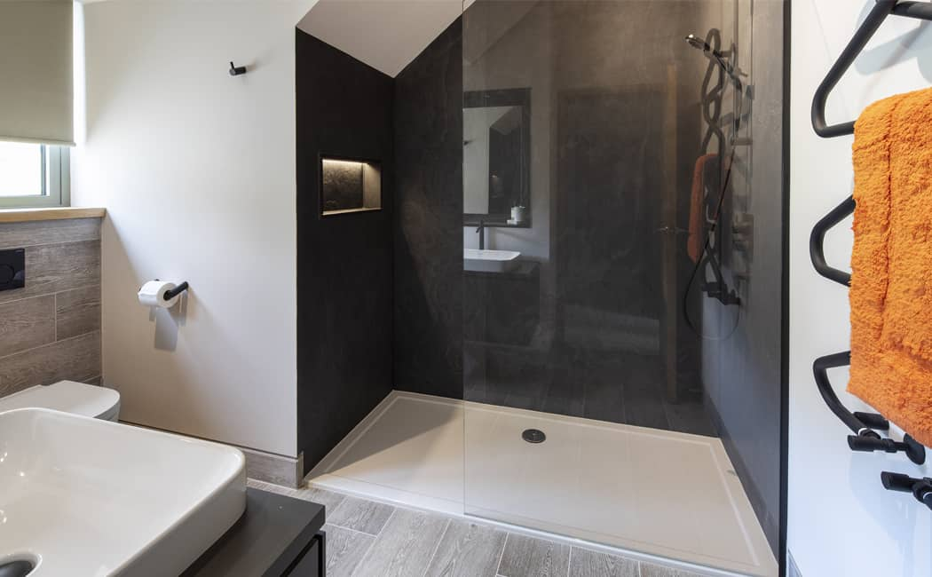 15 Textural Slate Finish Shower Area with Quirky Towel Rail
